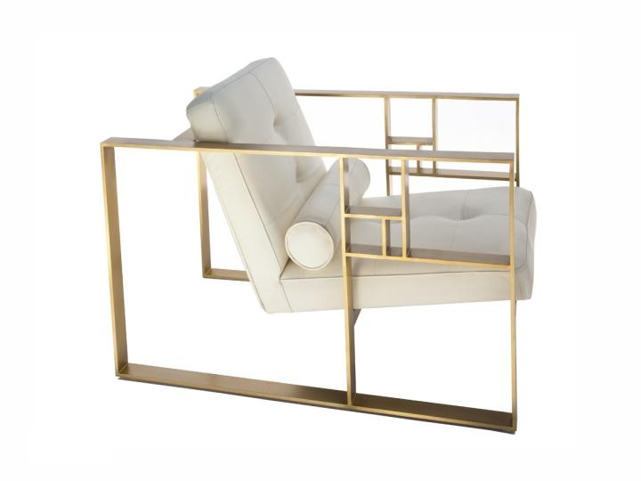 Подушка валик на белом кресле