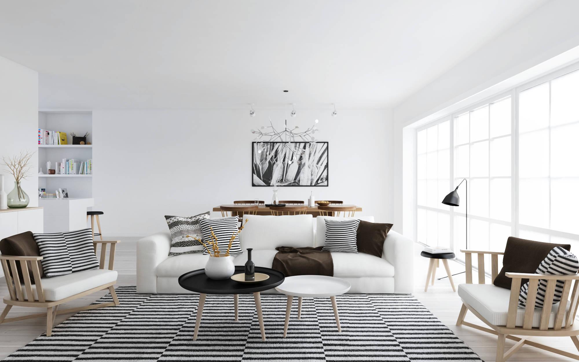 Черно-белые подушки на диване в гостиной