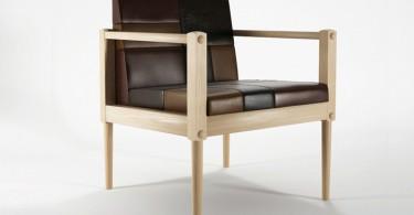 Стильный дизайн кожаного кресла с деревянными ручками
