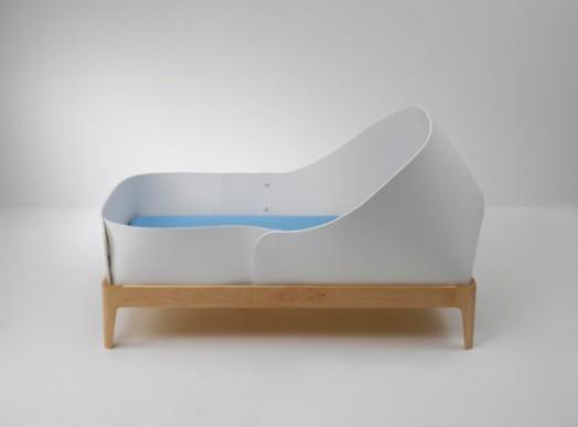 Боковой вид кроватки для новорожденных