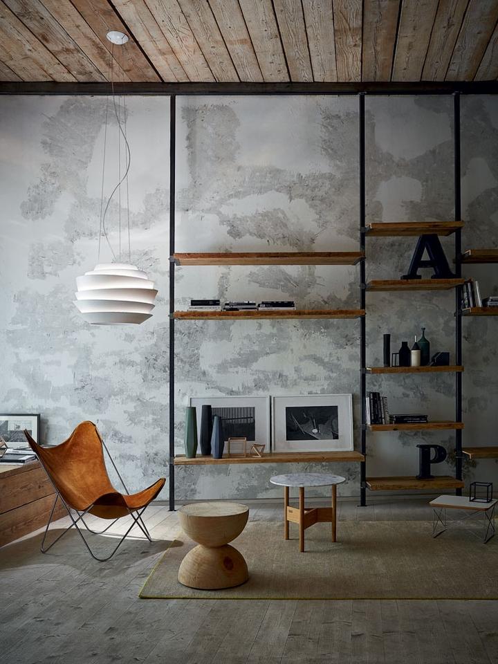 Оригинальный дизайн светильника Light Portraits круглой формы в индустриальном интерьере комнаты