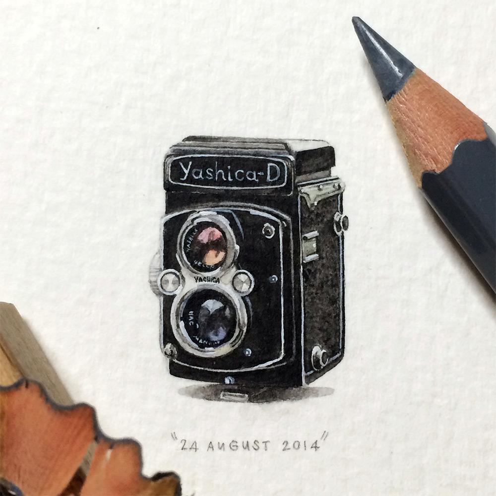 Рисунок ретро фотоаппарата в миниатюре