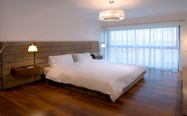 Круглый подвесной светильник в спальне