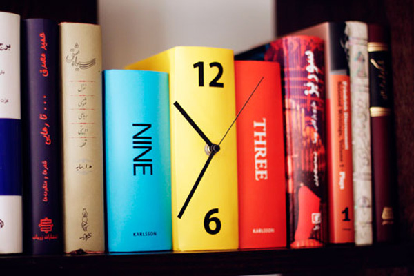 The original clock on the spine of the book is an unusual and functional piece of furniture.