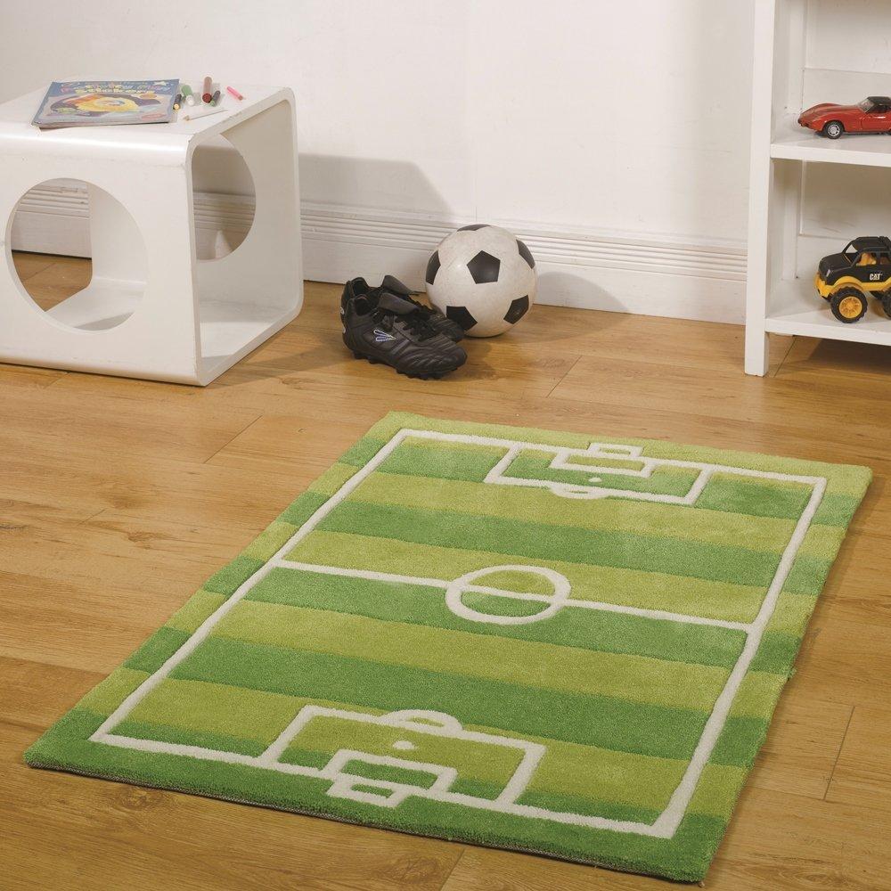 Ковер футбольное поле в интерьере детской