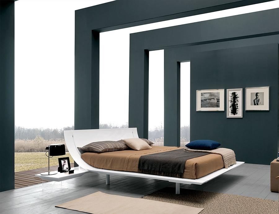 Современная кровать в интерьере открытой спальни
