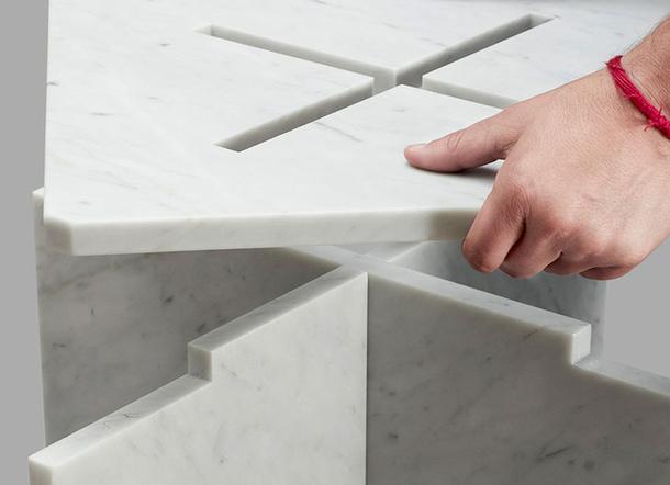 Демонстрация принципа складывания мраморного столика