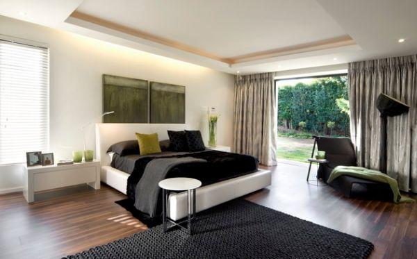 Черно-белая спальня с болотно-зелеными акцентами.