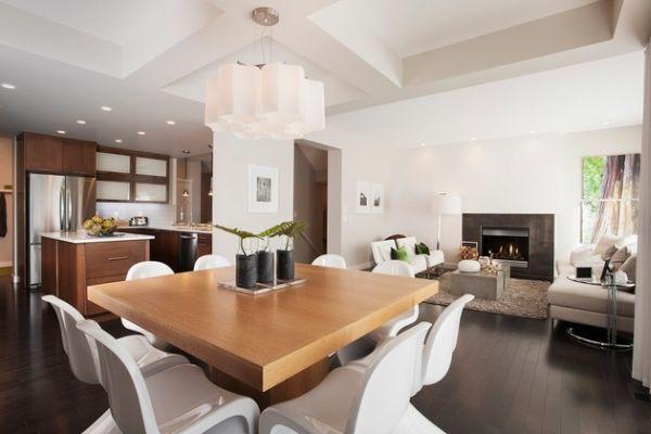 Для свежего и стильного дизайна - диванные подушки и комнатные растения.