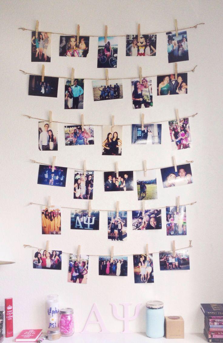 Фотографии на веревке, закрепленные прищепкой