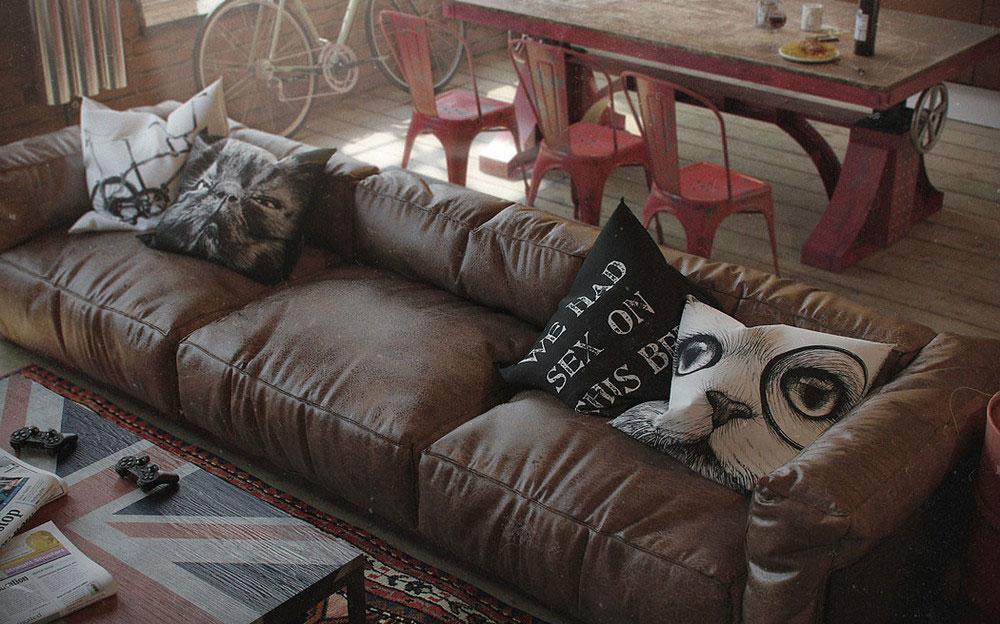 Подушки на кожаном диване в квартире-студии