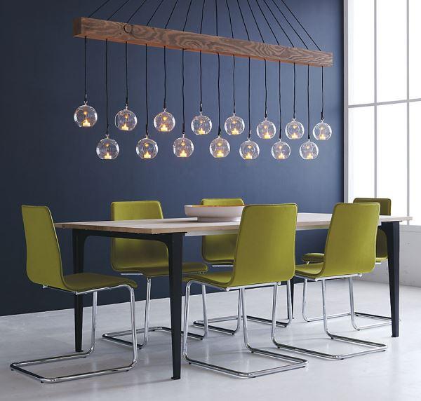 Оригинальные подвесные светильники над обеденным столом