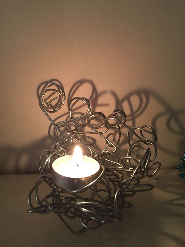 Свечка в проолочном держателе