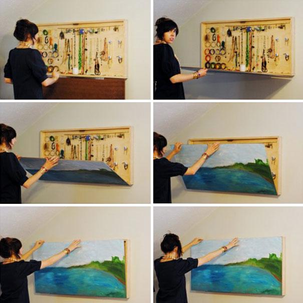Хранения аксессуаров на стеновой панели за картиной