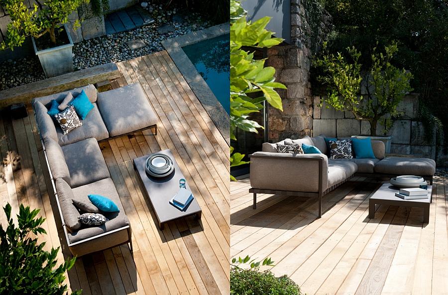 Чудесный диван, стол на террасе у бассейна с элементами декора