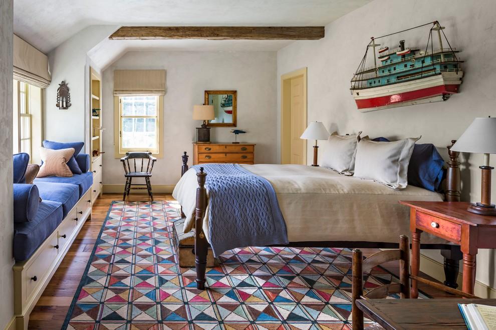 Фото разноцветного плетеного коврика с геометрическим рисунком в интерьере спальни