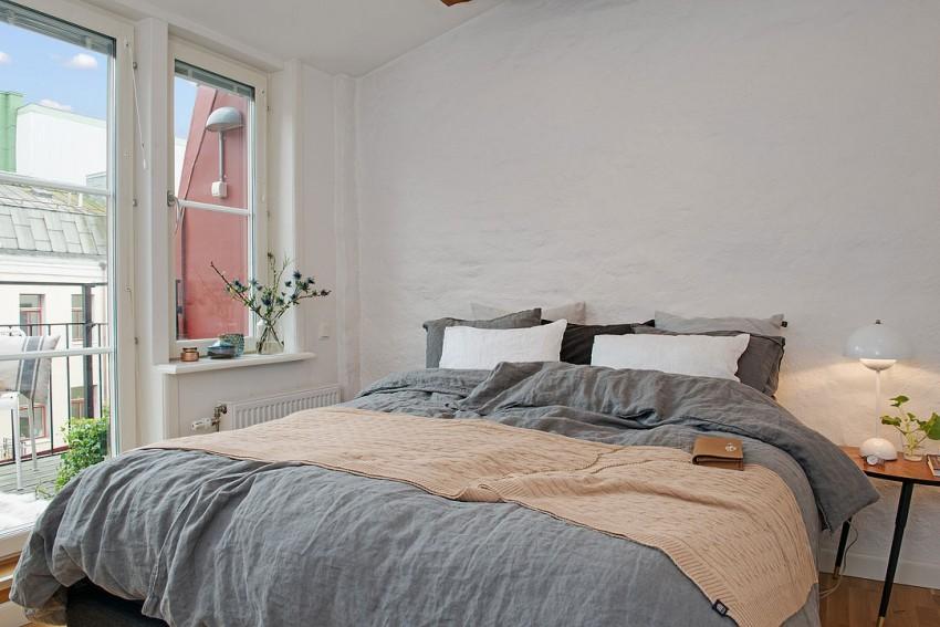 Скандинавский дизайн интерьера спальни квартиры в Швеции