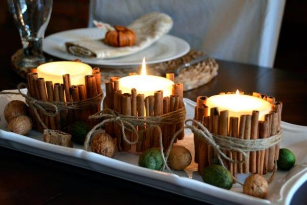 Свечи в кольце из коричных палочек