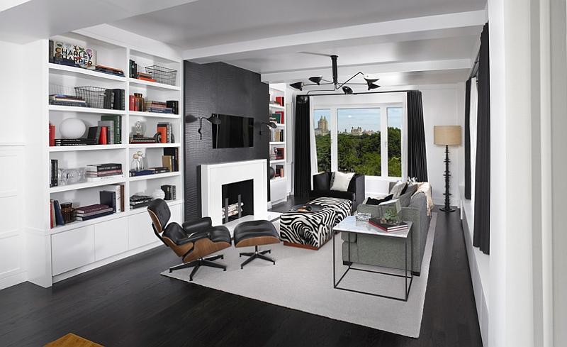 Черные осветительные приборы от Serge Mouille в гостиной