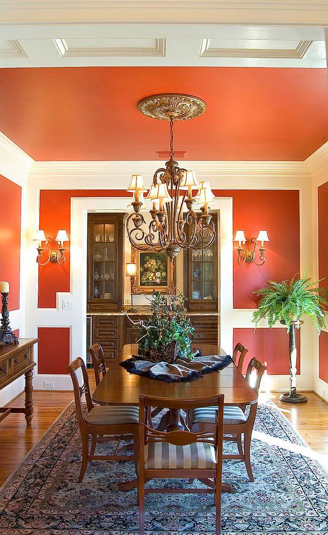 Сочетание оранжевого цвета в интерьере - ковёр сочетается с оранжевой отделкой стен и потолка