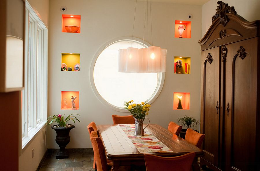 Сочетание оранжевого цвета в интерьере - огромное круглое окно