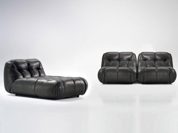 Яркий чёрный диван и кресло