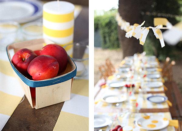 Коробка с персиками и белая свеча в жёлтую полоску