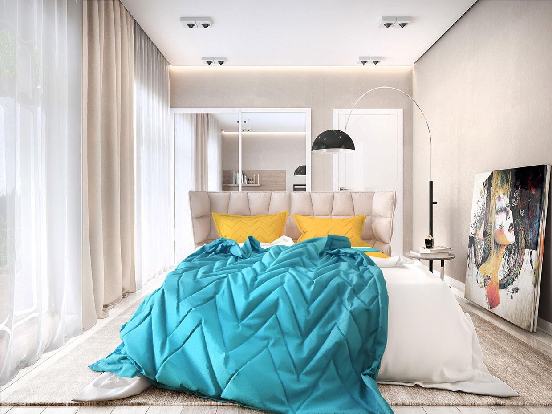 Яркое бирюзовое одеяло в спальне
